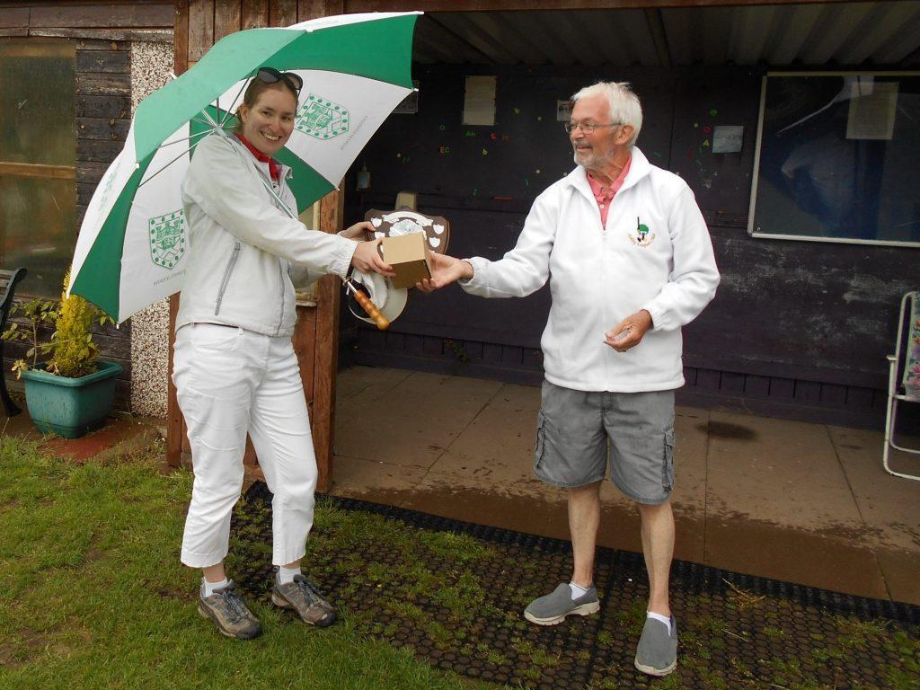 Rachel receiving the trophy from Mick